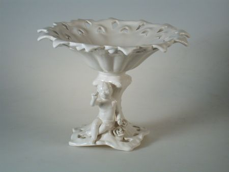 FRETWORK FURNISHING WITH PUTTO, HAND-MADE WHITE CERAMIC RAISED BOWL